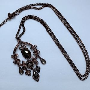 Long necklace with large pendant, copper tone